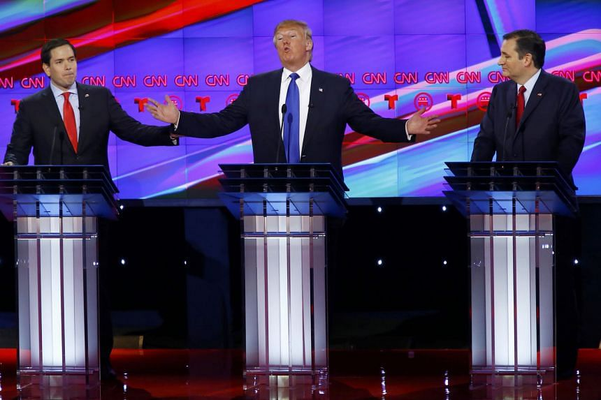 Mr Trump is flanked by Mr Rubio (far left) and Mr Cruz in Thursday's debate in Houston.The debate is the Republicans' most explosive one to date.
