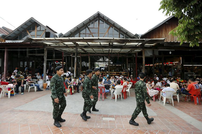 Thai soldiers patrolling a pier at Chao Phraya River in Bangkok on Feb 16. The Erawan Shrine attackers had planted a bomb at the Chao Phraya Princess Pier, where hundreds of Chinese tourists gather each day to board dinner cruises, but it failed to detona