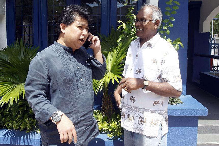 TMI editor and chief executive Jahabar Sadiq (left) and assistant news editor V. Anbalagan were among the staff members asked to give a statement to the police yesterday.
