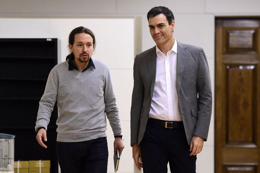 Spanish Socialist party leader Pedro Sanchez (right) and anti-austerity party Podemos leader Pablo Iglesias arriving for a meeting at the Spanish Parliament in Madrid on Feb 5.PHOTO: AGENCE FRANCE-PRESSE