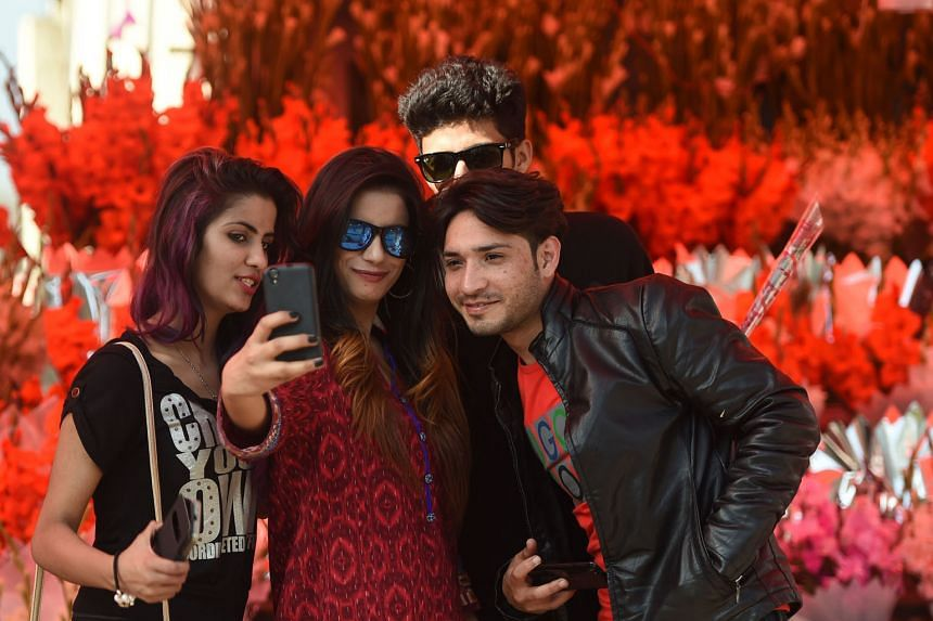 Young people in Islamabad taking a wefie. Strict religious and familial controls still dictate behaviour for many in Pakistan.