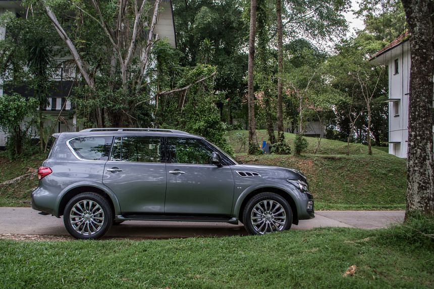 The Infiniti QX80 towers over the other SUVs on Singapore roads at 1.95m tall.