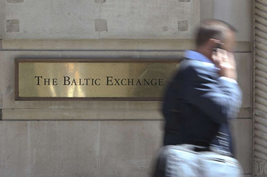 A man walks past the Baltic Exchange in London, UK, on June 16, 2010.