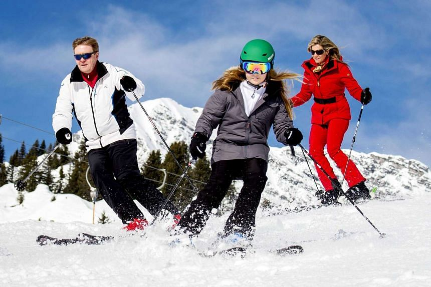 (From left) Dutch King Willem-Alexander, Princess Alexia and Queen Maxima ski during a photocall of the Dutch royal family in Lech am Arlberg, Austria, on Feb 22, 2016.