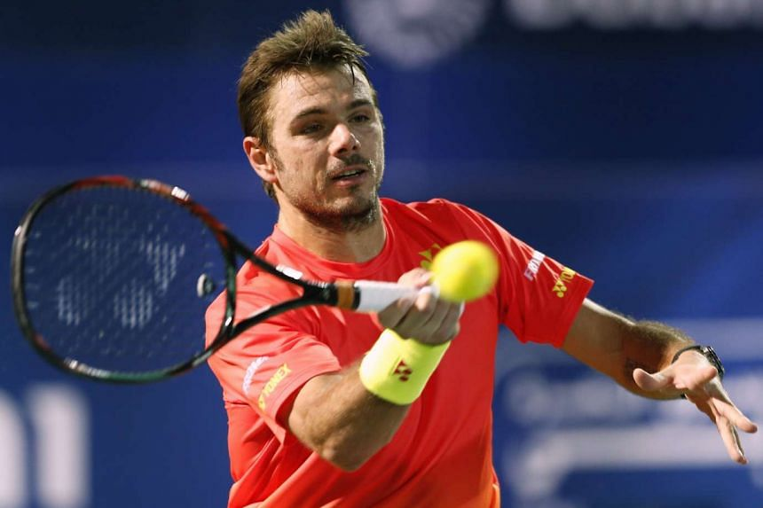 Stan Wawrinka of Switzerland returns the ball to Philipp Kohlschreiber of Germany during their ATP tennis match at Dubai Duty Free Tennis Championships on Feb 25, 2016.