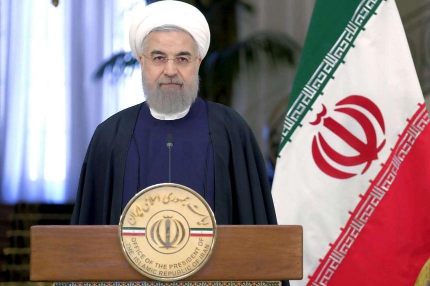 Iranian President Hassan Rouhani attend a news conference with Swiss President Johann Schneider-Ammann in Tehran on Feb 27, 2016.