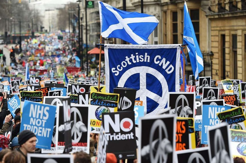 Anti-Trident demonstrators march during a protest organised by Campaign for Nuclear Disarmement (CND) titled 'Stop Trident' in London, Britain, on Feb 27, 2016.