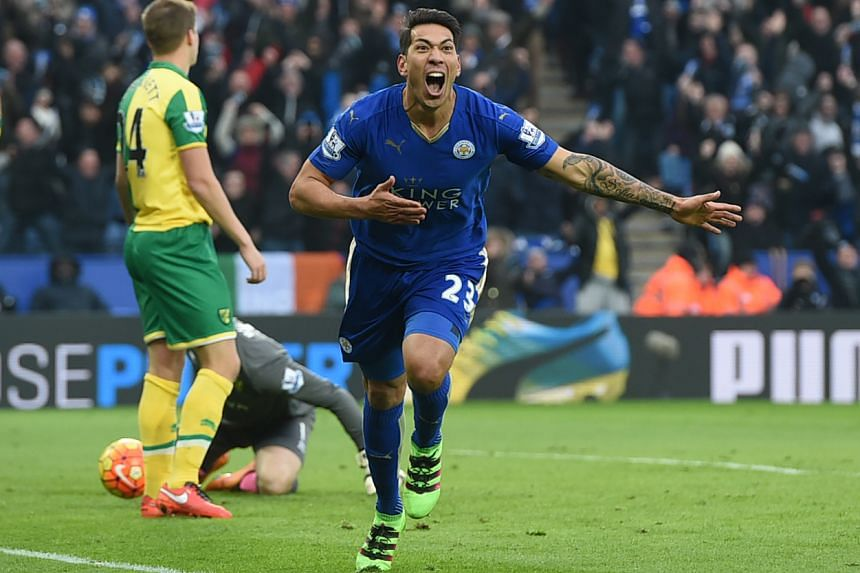 Leonardo Ulloa celebrates after scoring the first goal for Leicester City at the Barclays Premier League in King Power Stadium on Feb 27, 2016.