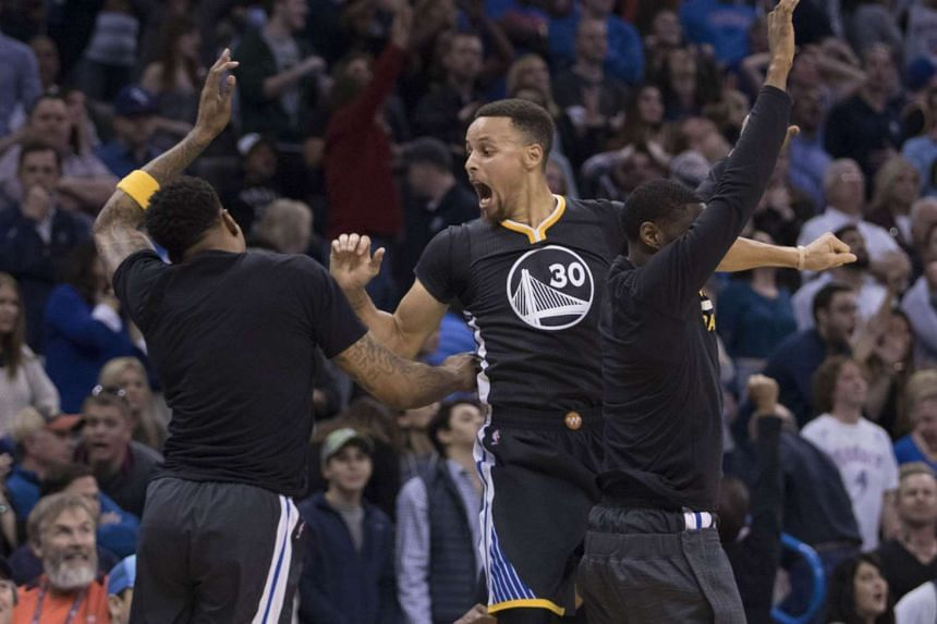 Golden State Warriors' Stephen Curry celebrates after scoring the winning three point shot during their game against the Oklahoma City Thunders on Feb 27, 2016.