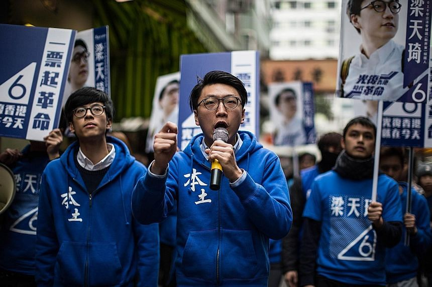 Mr Edward Leung (centre), a leader of the Hong Kong Indigenous activist group, speaking as he attends a pre-election campaign in Hong Kong yesterday. Hong Kongers head to the polls today to vote in a legislative by-election for a seat vacated by a pr