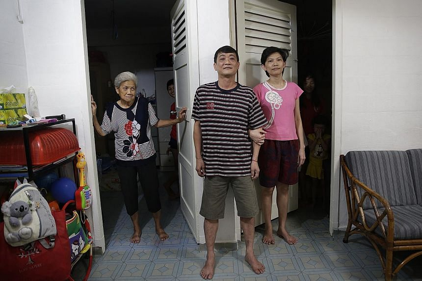 Mr Ong with his mother Ng Tang Neo, 72, and wife Chew Bee Lee, 36, and their three daughters. He puts in long hours as a cooked food stall assistant to make ends meet, working from around 7am till nearly 9pm.