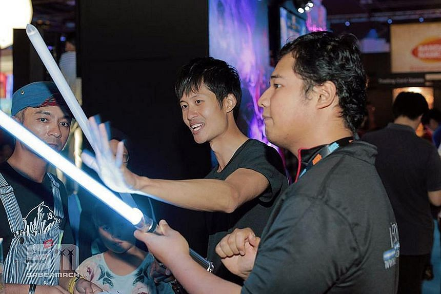 Mr Chen demonstrating his duel-ready, heavy-duty lightsabers at a roadshow last November.