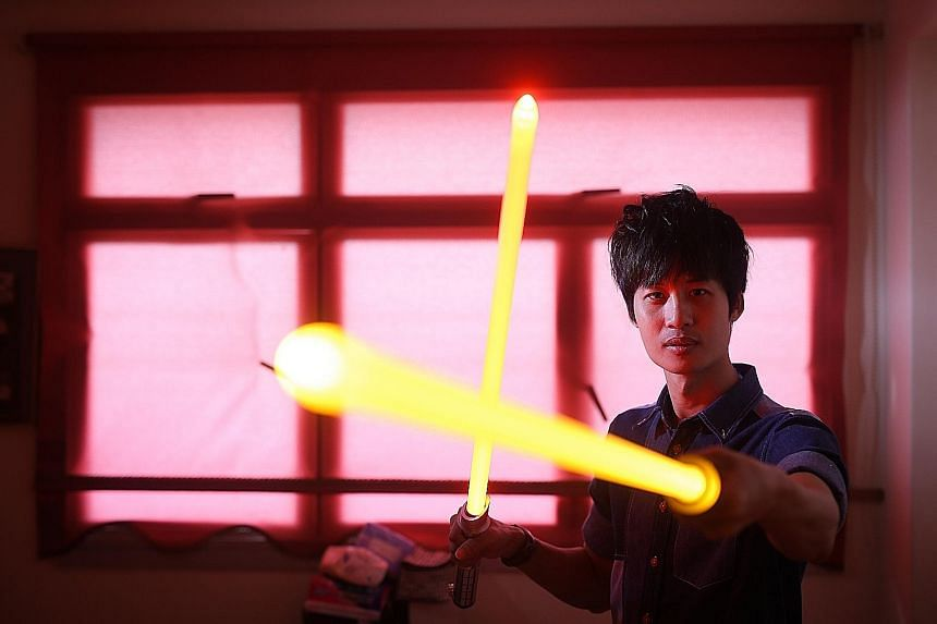 Mr Chen brandishing his sought-after handcrafted lightsabers. In September last year, his company, Sabermach, launched its range of heavy-duty combat lightsabers at a toy convention in Marina Bay Sands, with orders surging in by the hundreds. The 31-