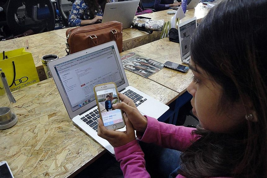 A member of the TrulyMadly staff in New Delhi demonstrating how her company's dating app works on the smartphone.