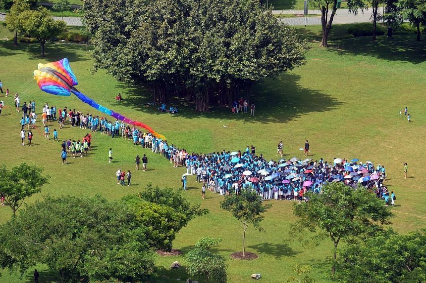 More than 660 people gathered at Bishan-Ang Mo Kio Park yesterday to mark the launch of the 20th-anniversary celebrations for the Down Syndrome Association (Singapore). The group earned a spot in the Singapore Book of Records for the most people asse