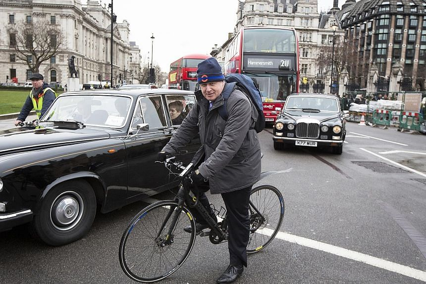 """Mr Johnson leaving the Houses of Parliament in London on his bicycle last Monday. The influential politician says he is """"massively pro-migrants"""" but cautioned that there is a need for managed immigration."""
