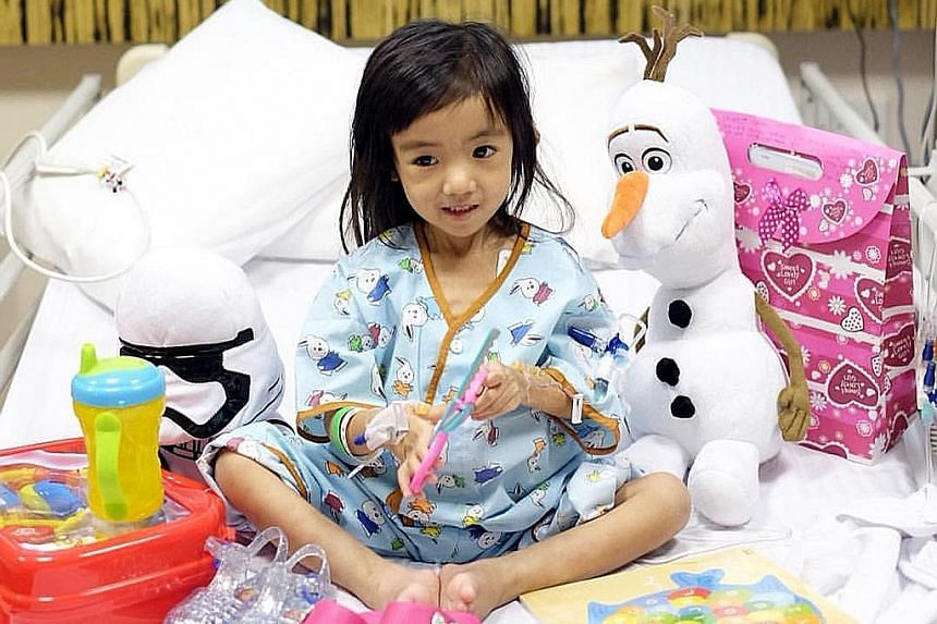 Three-year-old Caitlin in NUH among gifts from well-wishers. Doctors have been trying to find out how insect bites found on her ankle have gone on to cause life-threatening symptoms.