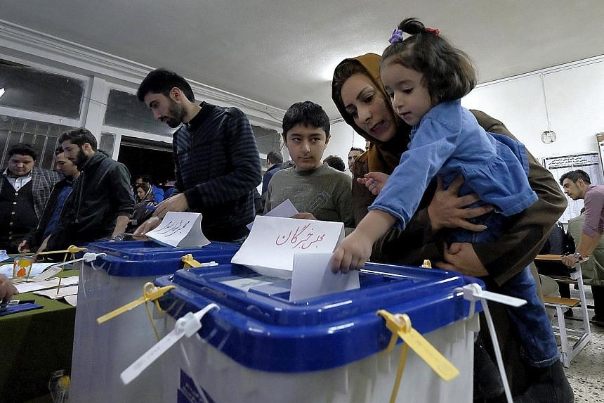 Tens of millions of Iranians voted in polls seen as a potential turning point for the country, which has the world's second-largest gas reserves.