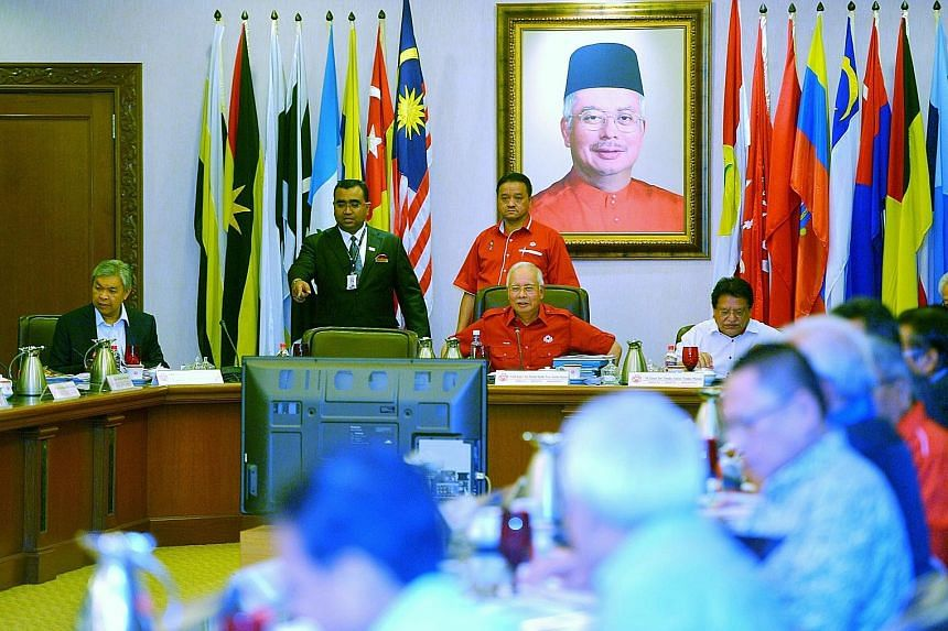 Mr Najib at an Umno meeting, with the seat on his right usually taken up by Mr Muhyiddin visibly empty on Friday.