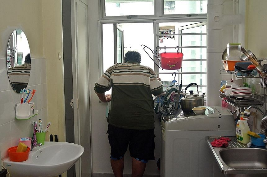 Mr Leck Wee Nee in his two-room rental flat in Clementi. Doctors have certified him to be unfit for work, he says.