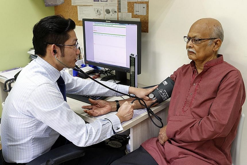 Dr Gilbert Yeo attending to Mr Sreedharan, who has diabetes and heart conditions. Mr Sreedharan has been visiting Ang Mo Kio FMC since September 2013 and appreciates the clinic's personalised approach.