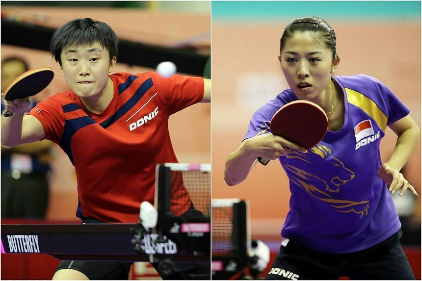 Singapore paddlers Feng Tianwei (left) and Yu Mengyu.