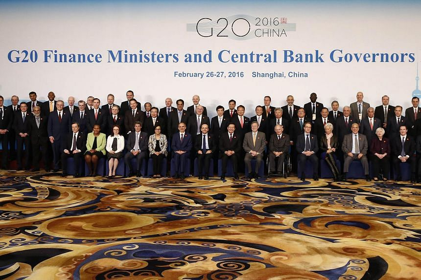 Officials pose for a group photo at the G-20 Finance Ministers and Central Bank Governors Meeting in Shanghai, on Feb 27, 2016.
