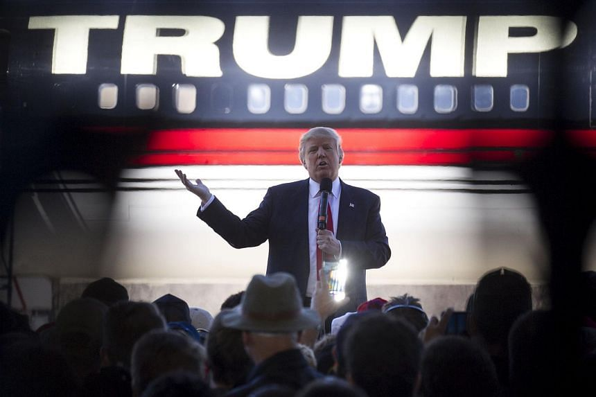 Republican presidential candidate Donald Trump talks to supporters at a campaign rally in an airplane hanger at Northwest Arkansas Regional Airport on Feb 27, 2016.