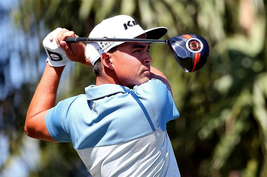 Rickie Fowler tees off on the third hole during the third round of the Honda Classic.