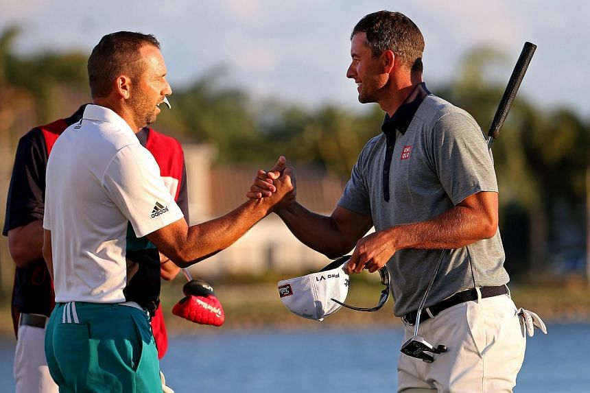 Sergio Garcia (left) and Adam Scott shake hands after the third round of the Honda Classic.