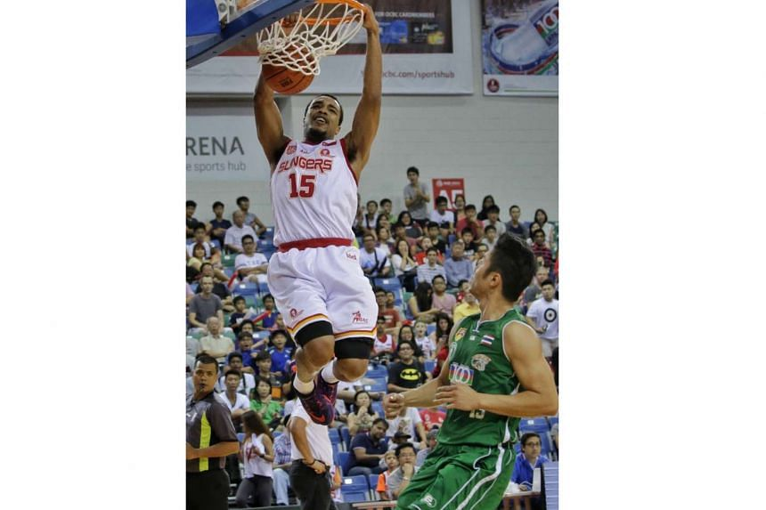 The Singapore Slingers' Xavier Allen Alexander dunks in front of face Hi-Tech Bangkok City's Piyapong Piroon in their first Asean Basketball League play-off semi-final match at the OCBC Arena, in a first-to-two wins series, on Feb 28, 2016.