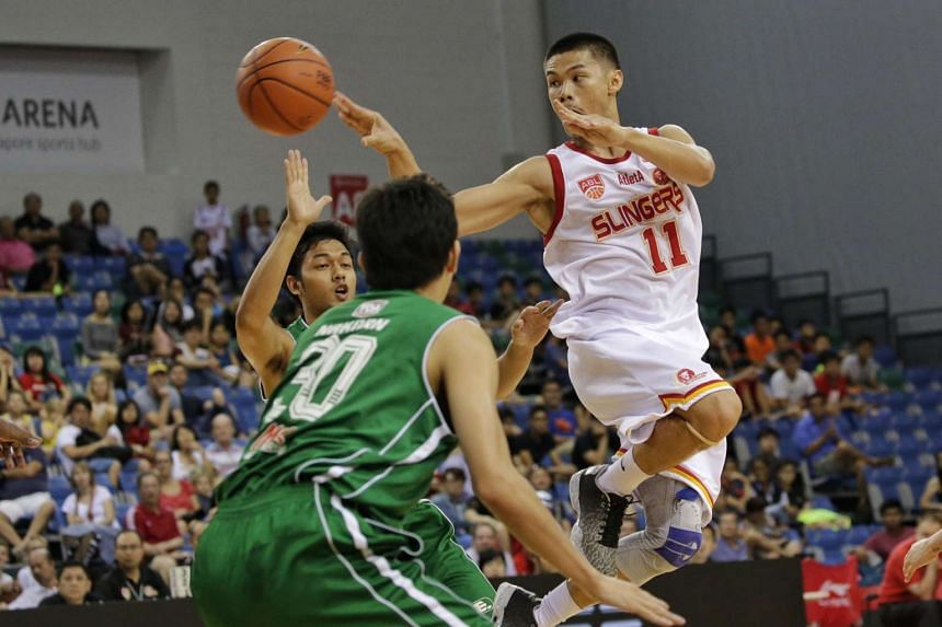 The Singapore Slingers' Krismoir Sajise Rosales places a pass through the defence of Hi-Tech Bangkok City in their first Asean Basketball League play-off semi-final match at the OCBC Arena, in a first-to-two wins series, on Feb 28, 2016.