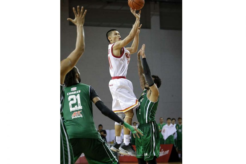 The Singapore Slingers' Krismoir Sajise Rosales shoots against Hi-Tech Bangkok City in their first Asean Basketball League play-off semi-final match at the OCBC Arena, in a first-to-two wins series, on Feb 28, 2016.