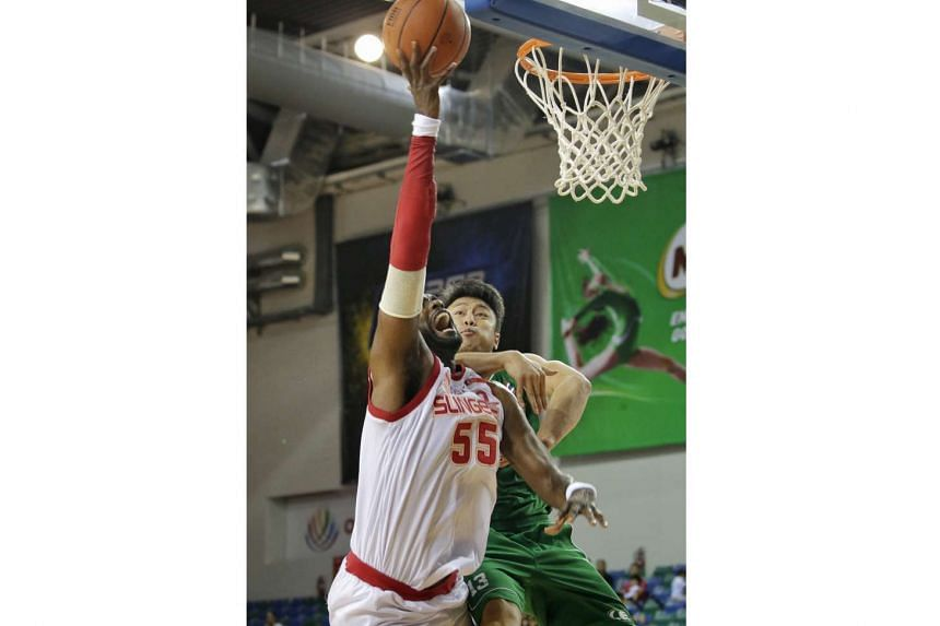 The Singapore Slingers' Justin Aronel Howard is fouled from behind by Hi-Tech Bangkok City's Piyapong Piroon in their first Asean Basketball League play-off semi-final match at the OCBC Arena, in a first-to-two wins series, on Feb 28, 2016.