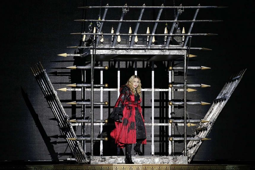 Pop superstar Madonna makes her entrance during her first concert in Singapore on Feb 28, 2016, as part of her Rebel Heart Tour .