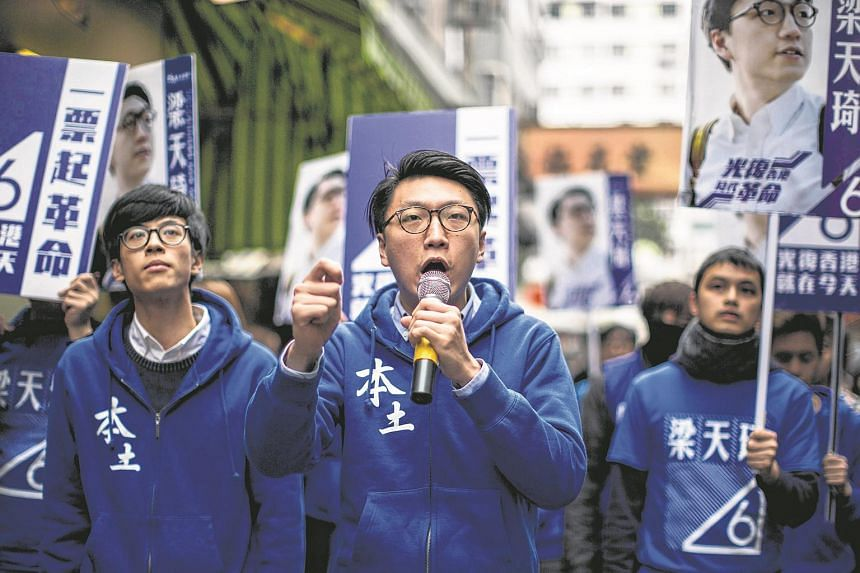 Edward Leung (centre) of the group Hong Kong Indigenous speaks as he attends a pre-election campaign event in Hong Kong on Feb 27, 2016.