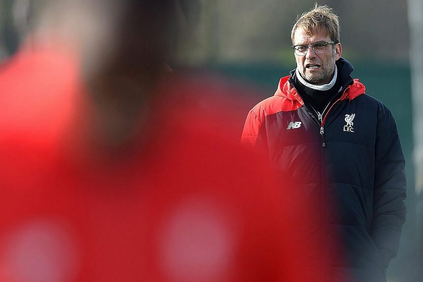 Liverpool's manager Jurgen Klopp attends a training session at Melwood training facility in Liverpool.