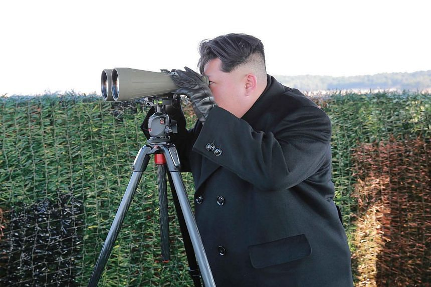 North Korean leader Kim Jong-Un inspecting the test-fire of a newly developed anti-tank guided weapon at an undisclosed location.