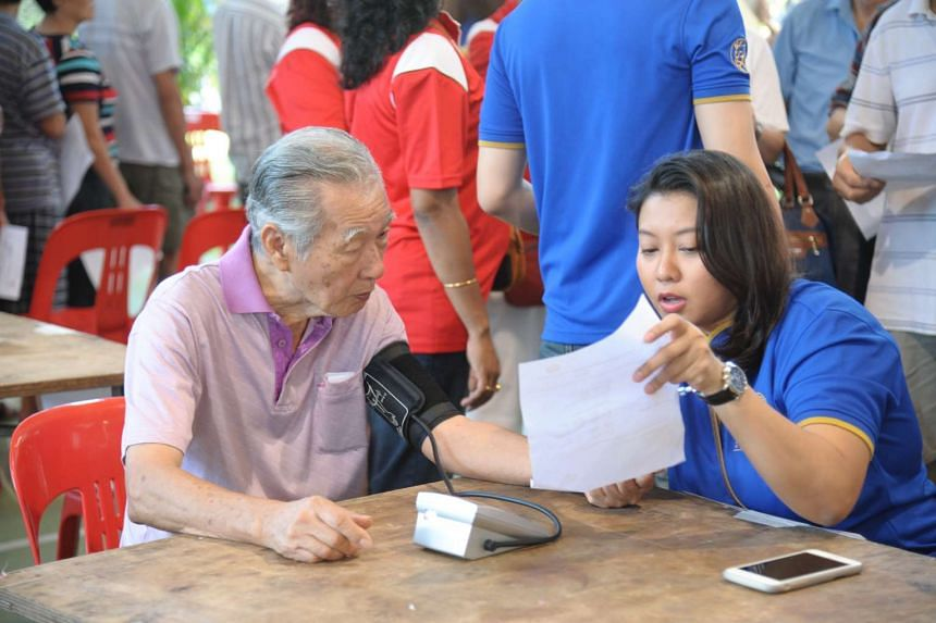 A resident has his blood pressure taken at a Health Carnival in Jurong on Feb 28, 2016.