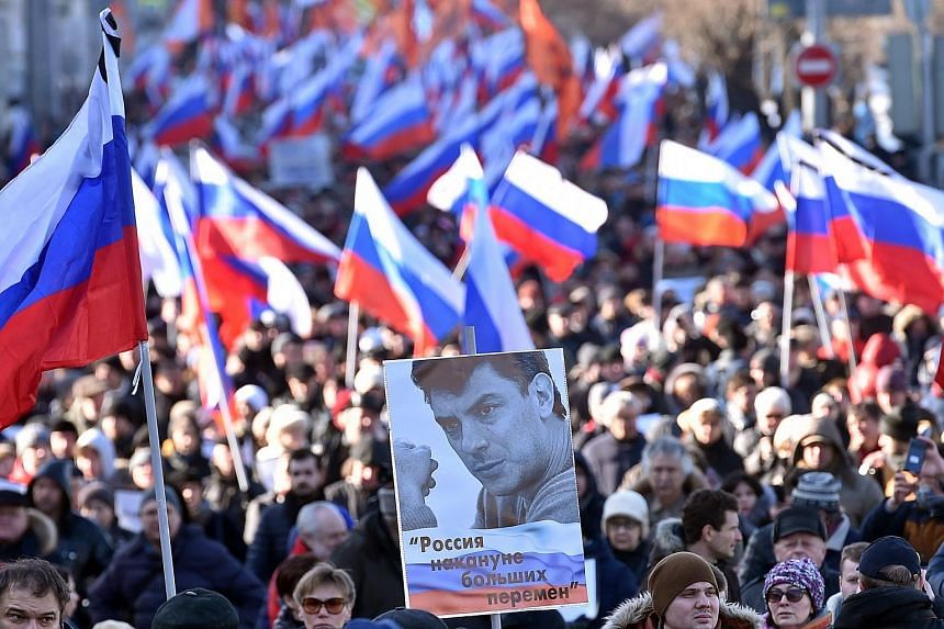 Supporters of slain Russian opposition leader Boris Nemtsov take part in a memorial march in central Moscow, on Feb 27, 2016.