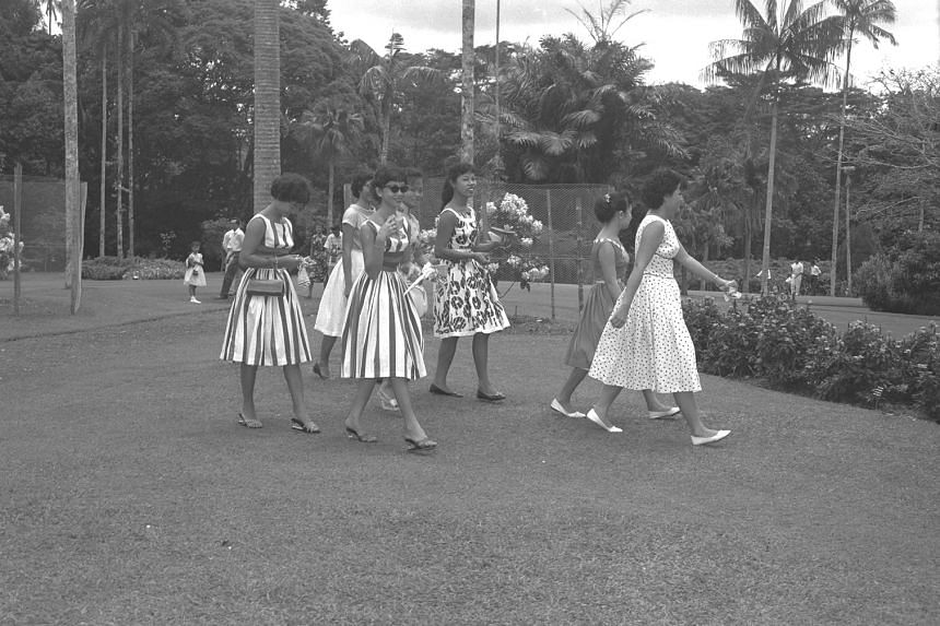 Merry makers parade in their holiday finery during Chinese New Year in 1959 as pictured in chapter five of the e-book - a section dedicated to the generations of visitors who have walked through the Gardens over the past 157 years.