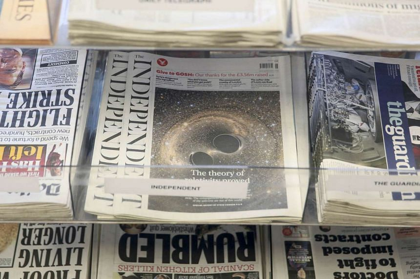Newspapers displayed for sale at a store in London, Britain on Feb 12, 2016.