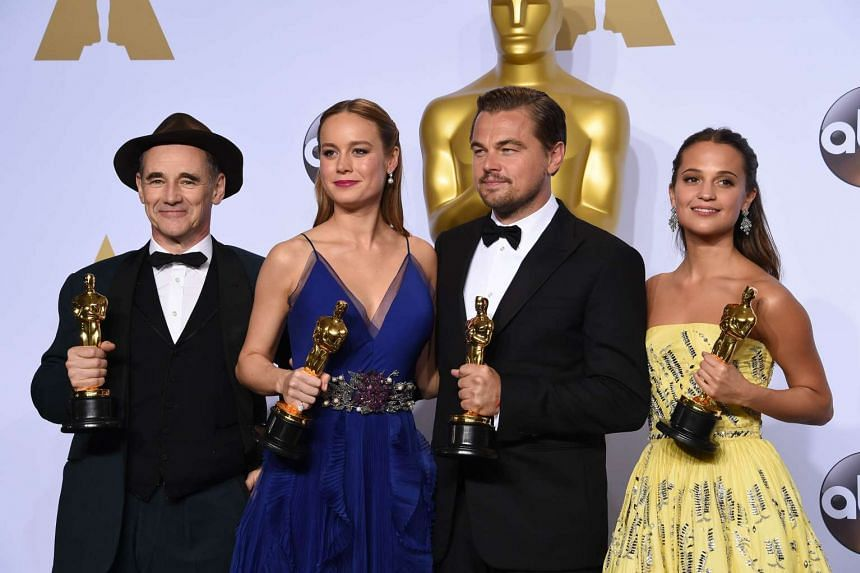 (From left) Best Supporting Actor Mark Rylance, Best Actress Brie Larson, Best Actor Leonardo DiCaprio and Best Supporting Actress Alicia Vikander pose with their Oscar in the press room during the 88th Oscars in Hollywood on Feb 28, 2016.
