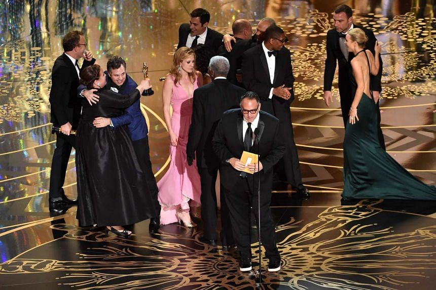 The producers and cast of Spotlight accept the Best Motion Picture of the Year award onstage during the 88th Annual Academy Awards at the Dolby Theatre on Feb 28, 2016 in Hollywood, California