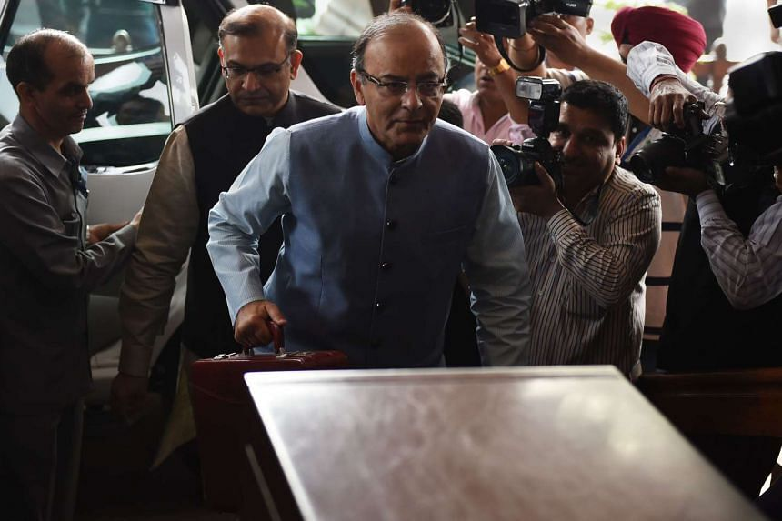"""Finance Minister Arun Jaitley (centre) said India's estimated 120 million farmers were the """"backbone of the country's food security""""."""