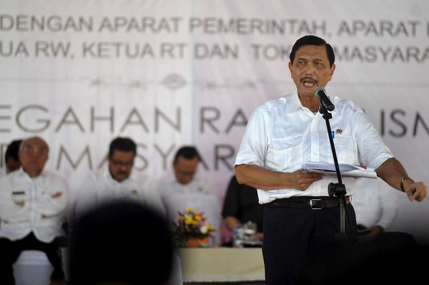 Indonesia's chief security affairs minister Luhut Pandjaitan speaks to local government and security officials in Serang, Indonesia on Feb 29, 2016.
