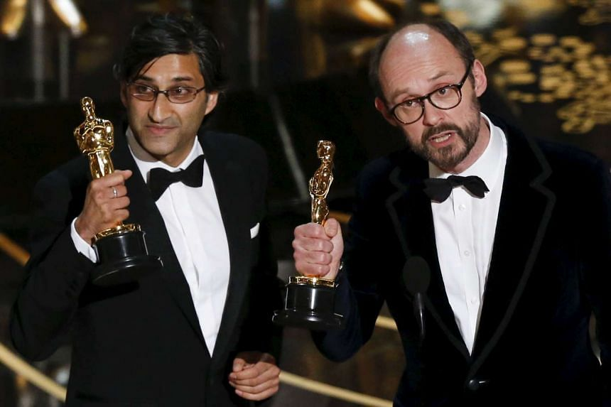 Asif Kapadia (left) and James Gay-Rees accept the Oscar for the Best Documentary Feature for their movie Amy, on Feb 28, 2016.