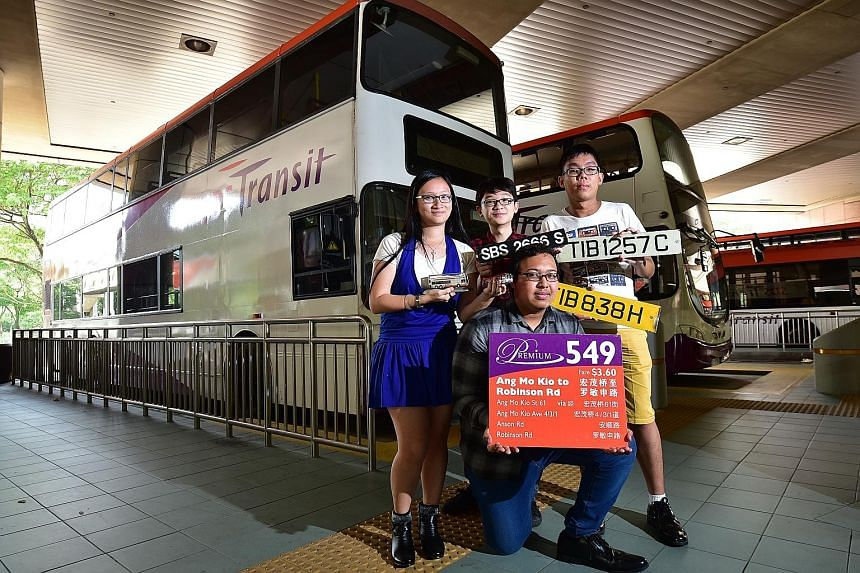Members of the Singapore Bus Spotters Association include (from left) university undergraduate Liu Ying Jun, 24; secondary school student Matthew Tay, 16; full-time national serviceman Teo Boon Kiat, 22; and (kneeling) Institute of Technical Educatio