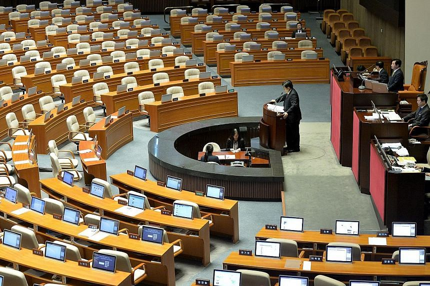 Opposition lawmaker Choi Kyu Sung speaking at the National Assembly in Seoul yesterday in a filibuster to block a security Bill.
