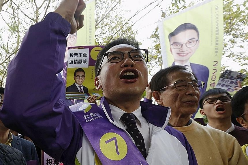 With activist Edward Leung (left) chipping away at the pro-democracy base, barrister Alvin Yeung (centre) is now running neck and neck with pro-establishment candidate Holden Chow (right).
